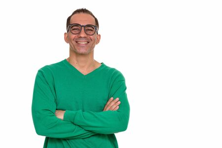 Mature happy Persian man with arms crossed