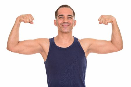Mature happy Persian man flexing both arms ready for gym Stock fotó
