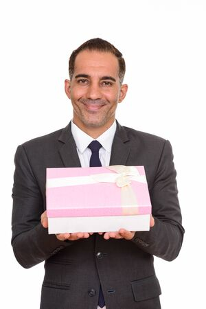 Happy mature Persian businessman holding gift box ready for Valentines day