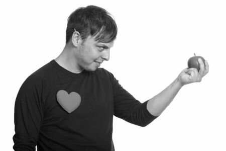 Profile view of crazy man holding apple ready for Valentines day