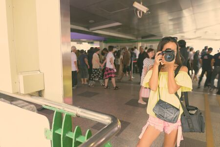 Portrait of young beautiful multi ethnic tourist woman exploring the city of Bangkok