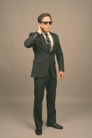 Portrait of handsome Persian businessman in suit Imagens