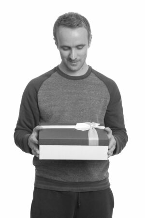 Portrait of handsome man with gift box
