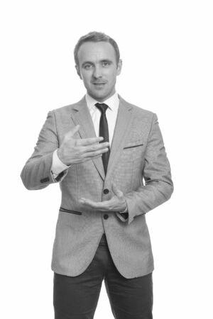 Portrait of handsome businessman in suit giving speech