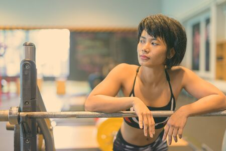 Young beautiful Asian woman working out at the gym Reklamní fotografie