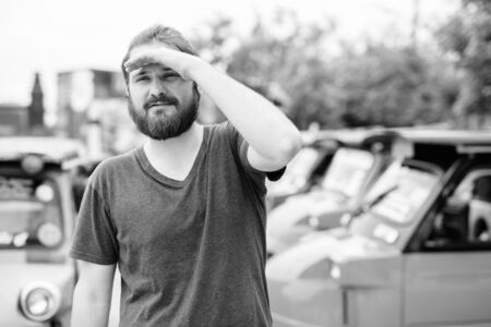 Portrait of young bearded tourist man having vacation 写真素材