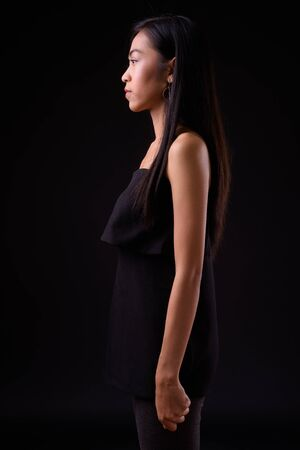 Profile view of young beautiful Asian woman
