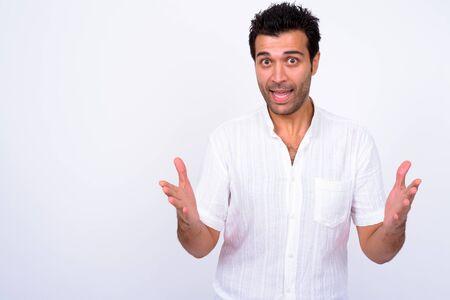 Portrait of happy handsome Turkish man explaining something
