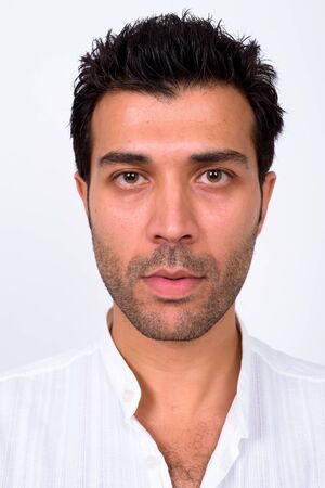 Face of handsome Turkish man looking at camera