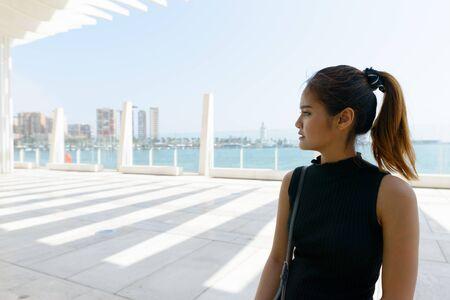 Beautiful woman thinking at Port of Malaga Spain Stock Photo