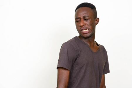 Portrait of stressed young African man looking disgusted