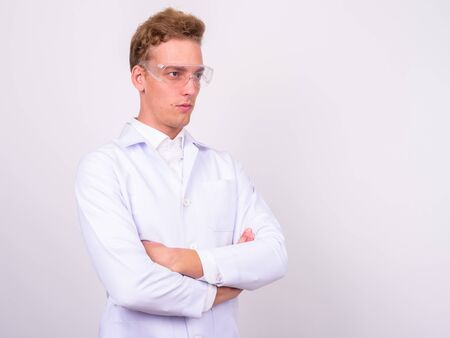 Young handsome Scandinavian man doctor against white background Stock Photo