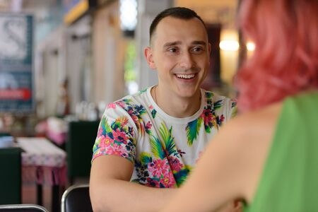 Happy handsome man having date with woman at the restaurant