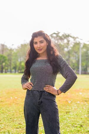 Young beautiful Indian woman at the park outdoors 写真素材