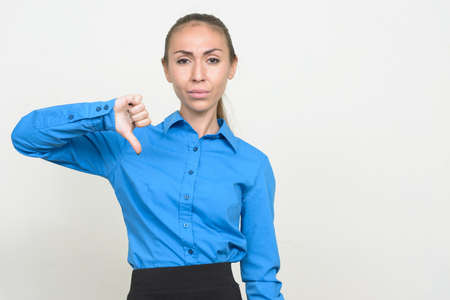 Portrait of young businesswoman giving thumbs down