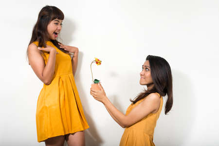 Portrait of two happy young Asian women together