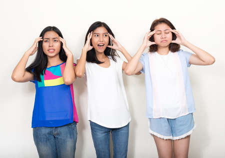 Portrait of three young beautiful Asian teenage girls as friends together