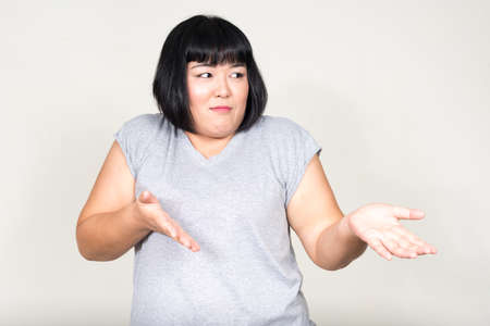 Portrait of young beautiful overweight Asian woman Imagens