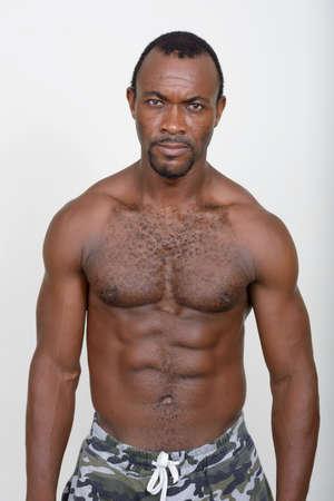 Portrait of handsome muscular bearded African man shirtless Foto de archivo