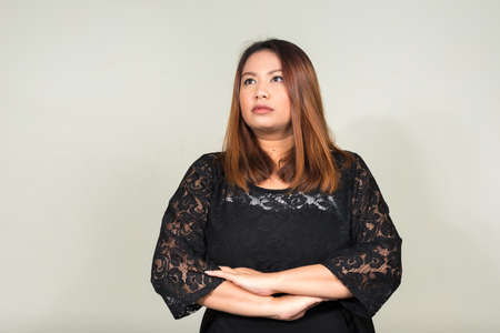 Portrait of young beautiful overweight Asian businesswoman