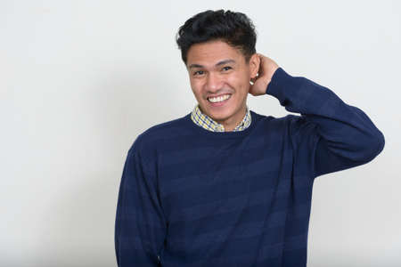 Portrait of handsome Asian man with sweater