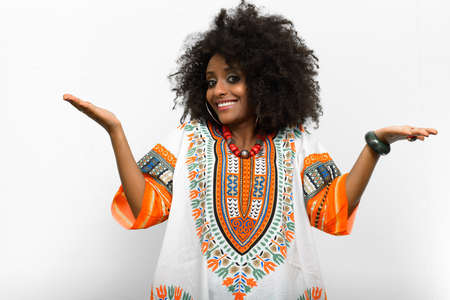Young beautiful African woman with Afro hair wearing traditional clothes 写真素材