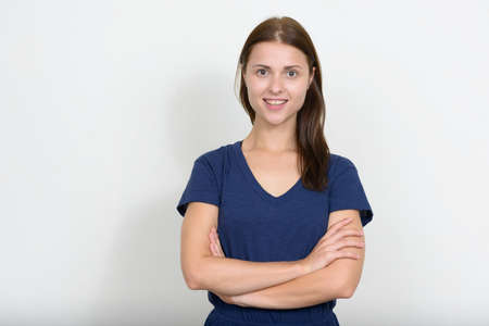 Portrait of young beautiful woman against white background