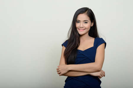 Portrait of happy young beautiful Asian woman Banque d'images