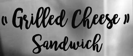 Grilled Cheese Sandwich sign against gray background