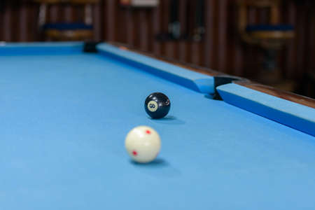 Billiard table with two balls ready for playing