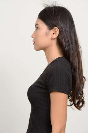Profile view of young beautiful Asian woman Stock Photo