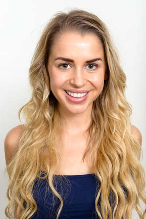 Portrait of young beautiful woman with blonde hair