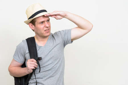 Portrait of young handsome tourist man ready for vacation