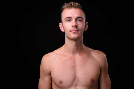 Portrait of young handsome shirtless man with blond hair