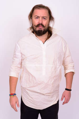 Bearded man with mustache and long hair against white background