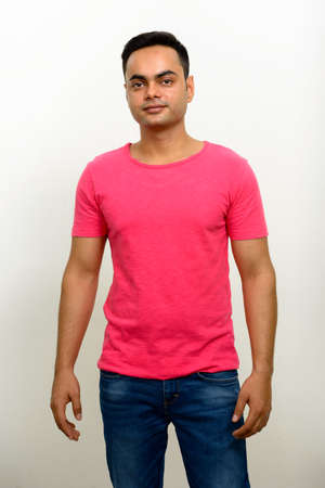 Portrait of young handsome Indian man against white background 스톡 콘텐츠