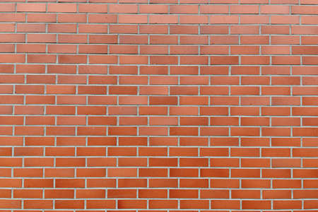 Portrait of brown brick wall as abstract background