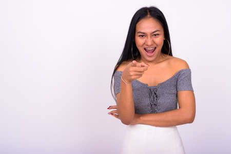 Young beautiful Asian woman against white background Archivio Fotografico