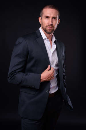 Portrait of handsome bearded businessman in suit