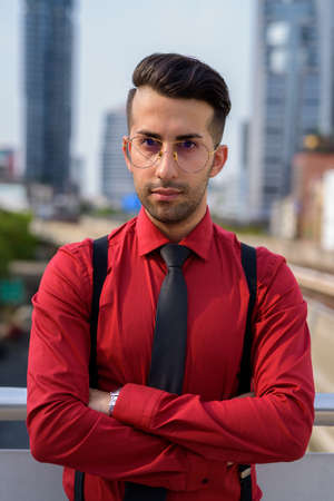 Young handsome Persian businessman exploring the city