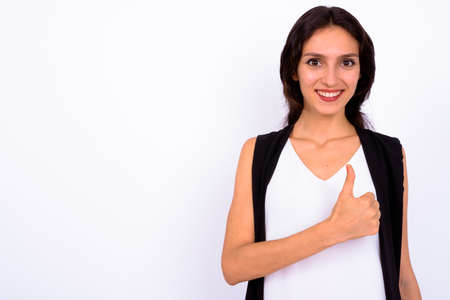 Portrait of happy young beautiful businesswoman against white background