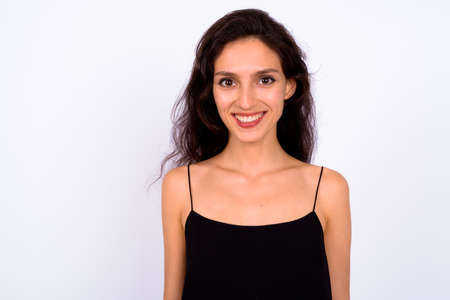 Portrait of happy young beautiful woman against white background
