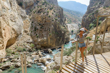Beautiful woman hiking in mountains at the Kings little pathway in Spain