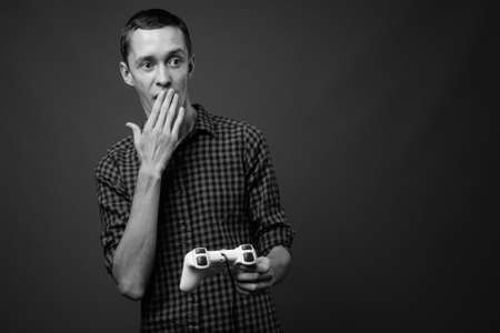 Portrait of young hipster man playing games Stock fotó