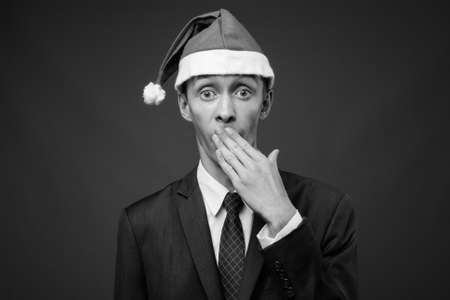 Portrait of young businessman with Santa hat ready for Christmas Stock fotó