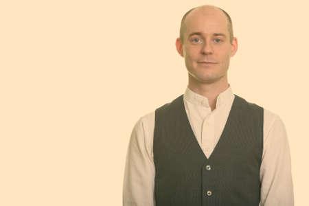 Portrait of handsome bald businessman looking at camera
