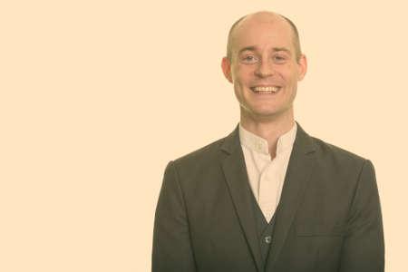 Portrait of happy handsome bald businessman in suit smiling 版權商用圖片
