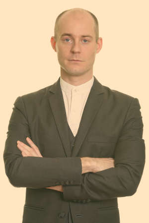Close up of bald Caucasian businessman with arms crossed 版權商用圖片