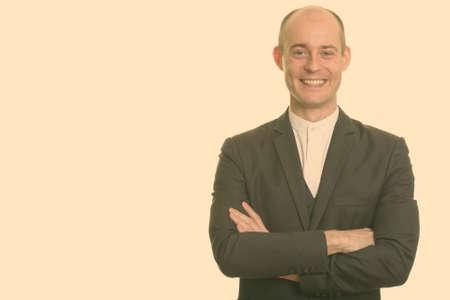 Happy bald Caucasian businessman smiling with arms crossed 版權商用圖片