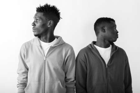Profile view of two young African men looking at different directions Imagens